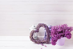 Fresh splendid lilac flowers, heart  and lanterns  with candles Royalty Free Stock Photos