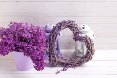 Fresh splendid lilac flowers  and lanterns  with candles on whi Stock Image
