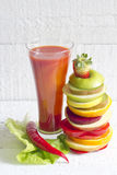 Fresh spring juice and pile of slice fruits and vegetables Stock Image