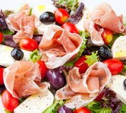 Fresh spring mix salad italian style with prosciutto and mozzare Royalty Free Stock Images