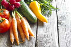 Fresh spring organic vegetables on wooden board Royalty Free Stock Photos