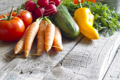 Fresh spring organic vegetables on wooden board Royalty Free Stock Images