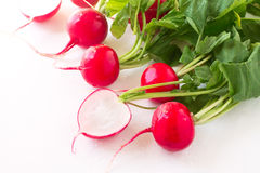Fresh spring radish. On a white background Stock Photo