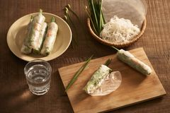 Fresh spring rolls with shrimps on bamboo dish stock photography