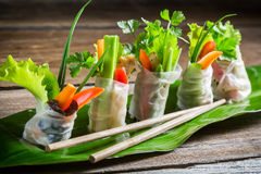 Fresh spring rolls wrapped in rice paper. On old wooden table Royalty Free Stock Image