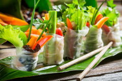 Fresh spring rolls wrapped in rice paper. On old wooden table Royalty Free Stock Photography
