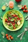 Fresh spring salad with arugula, spinach, beet leaves, tomatoes, cucumber slices and sweet pepper Royalty Free Stock Photography