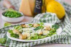Fresh spring salad with lettuce, eggs, cheese, croutons, green Stock Photo
