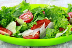 Fresh spring salad with tomatoes Stock Photos