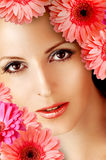 Beautiful woman with gerbera flowers Stock Photo