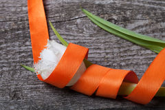 Fresh spring tulip close up with orange ribbon on old gray woode Royalty Free Stock Image