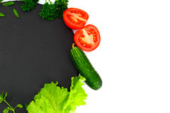 Fresh Spring Vegetables, Greens and Empty Black Plate with Place Royalty Free Stock Photo