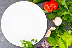 Fresh Spring Vegetables, Greens and Empty  Plate with Place for Stock Photos