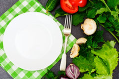 Fresh Spring Vegetables, Greens and Empty White Plate with Place Stock Images
