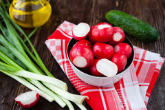 Fresh spring vegetables, radishes and onions. Closeup Stock Images