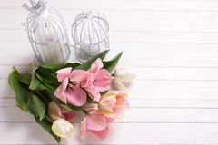 Fresh  spring white and pink  tulips and candles in decorative b Stock Image