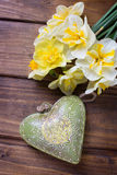 Fresh  spring yellow  daffodils  flowers and decorative heart Stock Image