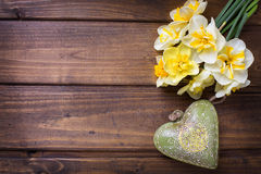 Fresh  spring yellow  daffodils  flowers and  green decorative h Stock Photo