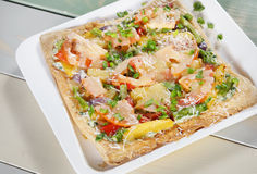 Fresh square pizza on a plate Royalty Free Stock Image