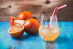 Fresh squeezed orange juice coctail and blood oranges Stock Photo