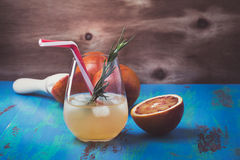 Fresh squeezed orange juice coctail and blood oranges, tequila p Royalty Free Stock Images