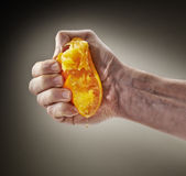 Fresh Squeezed Orange Juice by male hand Stock Photos