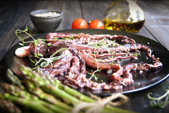 Fresh squid with an asparagus Royalty Free Stock Photo