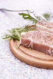 Fresh squid carcass in a glass pot with herbs and sliced lemon. Fresh Raw Steak Meat with spaces, herbs and vegetables on wooden board, selective focus Stock Photos