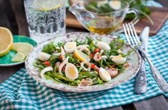 Fresh squid, eggs and arugula salad Stock Image