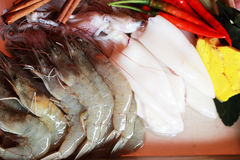 Fresh squid and fresh shrimp with garnish for soup. Stock Photos