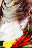Fresh squid and fresh shrimp with garnish for soup. Stock Photo