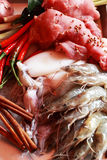 Fresh squid and fresh shrimp and pork with garnish for soup. Royalty Free Stock Images