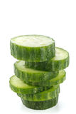 Fresh stacked cucumber. Layered stack of fresh cucumber slices on a white background Royalty Free Stock Photos