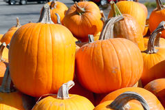 FRESH, STACKED PUMPKINS ON A WOODEN WAGON Royalty Free Stock Image