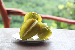 Fresh star fruit in dish. Stock Images