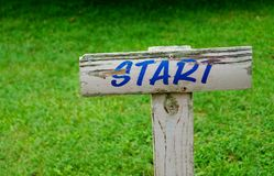 Start Sign New Beginning. A weathered wooden start sign marks the beginning of something new Stock Images