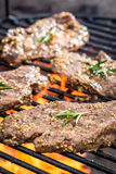 Fresh steak on the grill with fire Stock Photo