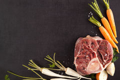 Fresh steak with vegetables from above. Fresh vegetables and steak meat from above with copyspace Stock Image