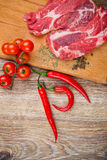 Fresh steaks with vegetables Stock Images