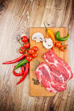 Fresh steaks with vegetables Royalty Free Stock Image