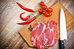 Fresh steaks with vegetables Royalty Free Stock Photo
