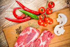 Fresh steaks with vegetables Royalty Free Stock Photography