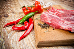 Fresh steaks with vegetables Royalty Free Stock Images