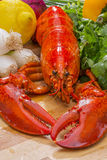 Fresh Steamed Lobster with Lemon and Fresh Vegetables Stock Photography