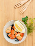 Fresh steamed red crabs leg in bowl . Red crabs leg with ingredi Royalty Free Stock Photography