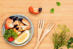 Fresh steamed red crabs leg in bowl . Red crabs leg with ingredi Stock Photos