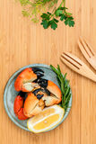 Fresh steamed red crabs leg in bowl . Red crabs leg with ingredi Stock Images