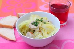 Fresh stew of cabbage with sausage Royalty Free Stock Image