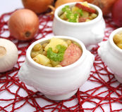 Fresh stew of peas. Some fresh stews of peas, potatoes and sausage Royalty Free Stock Photography