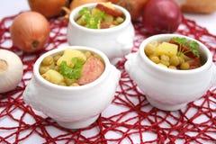 Fresh stew of peas. Some fresh stews of peas, potatoes and sausage Royalty Free Stock Photo